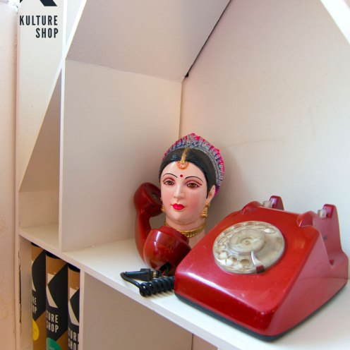 Indian Doll head & retro telephone